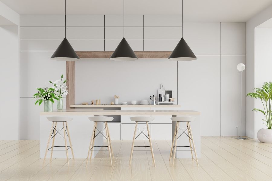 minimalist white kitchen with three big black ceiling lamps