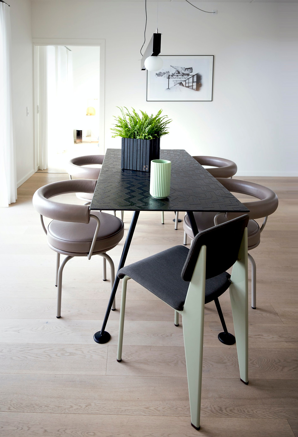 minimalist dining room with leather chairs