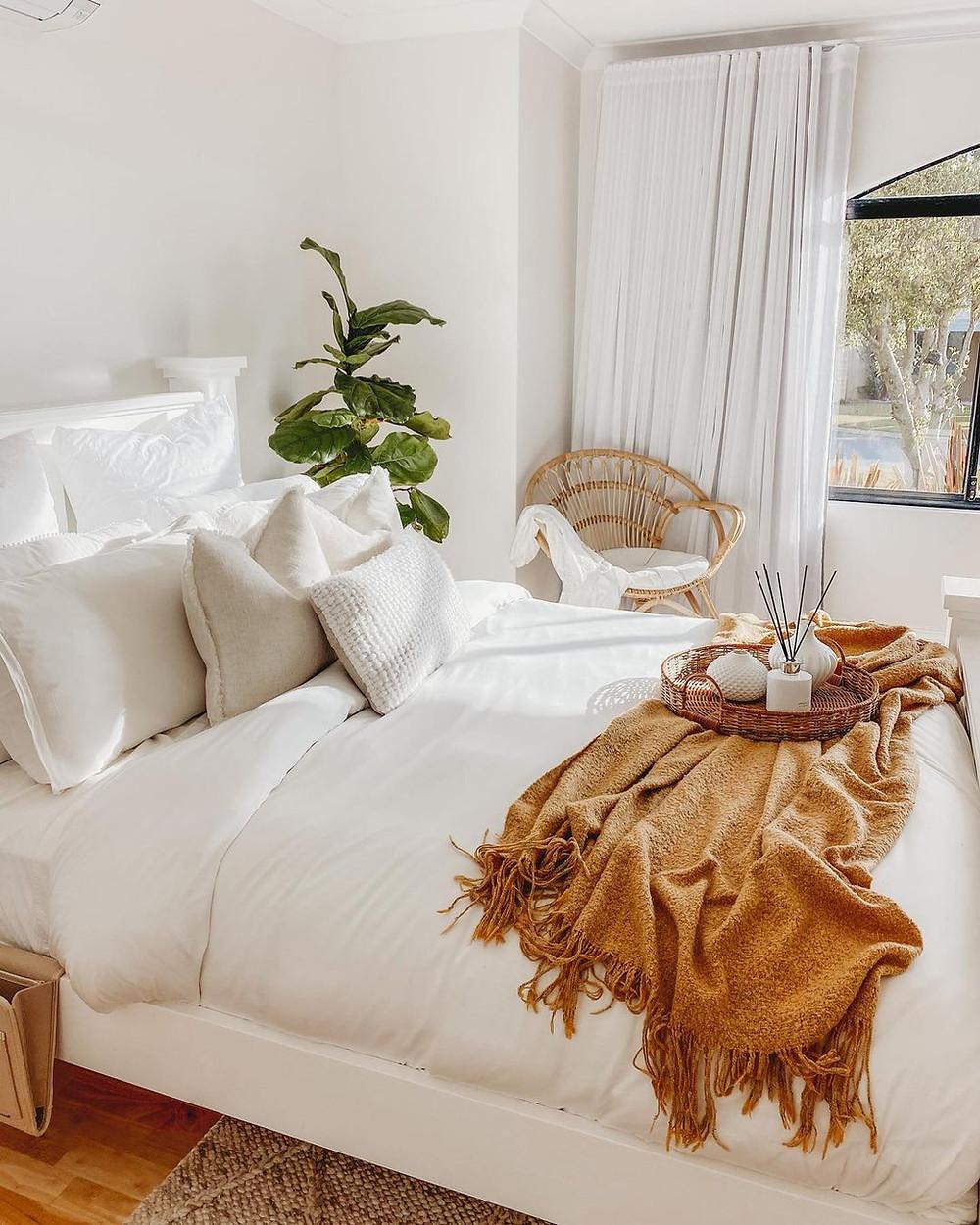bohemian minimalist bedroom with marigold bed throw