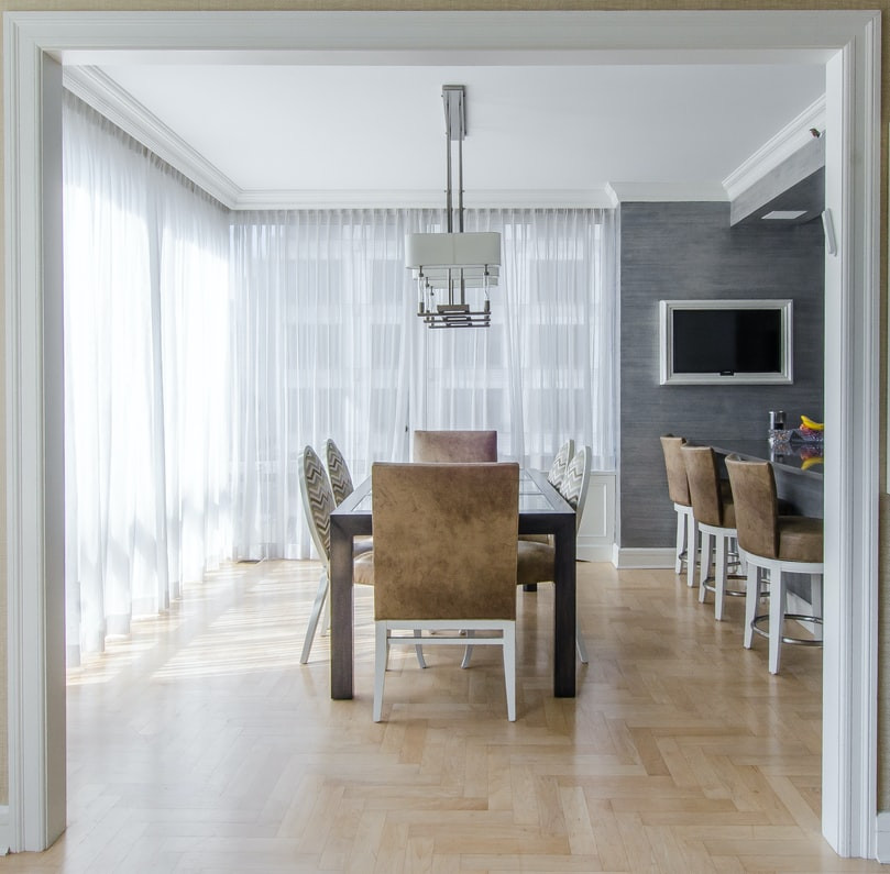 minimalist dining room with leather chairs and natural light