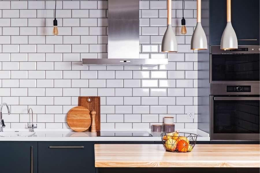 minimalist kitchen grey backsplash and black cabinets