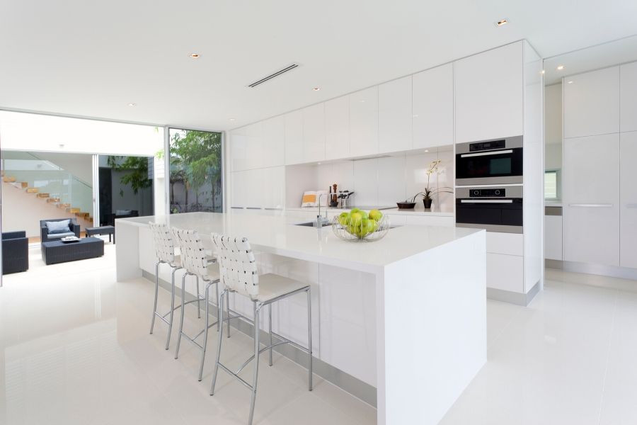 minimalist kitchen all white floor and cabinets