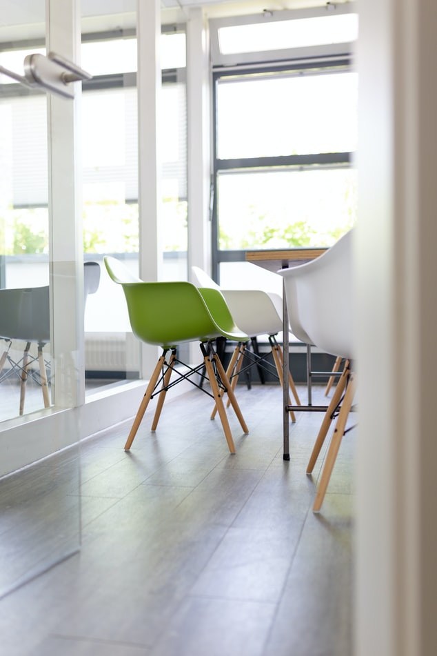minimalist modern dining room with plastic chair in different colors