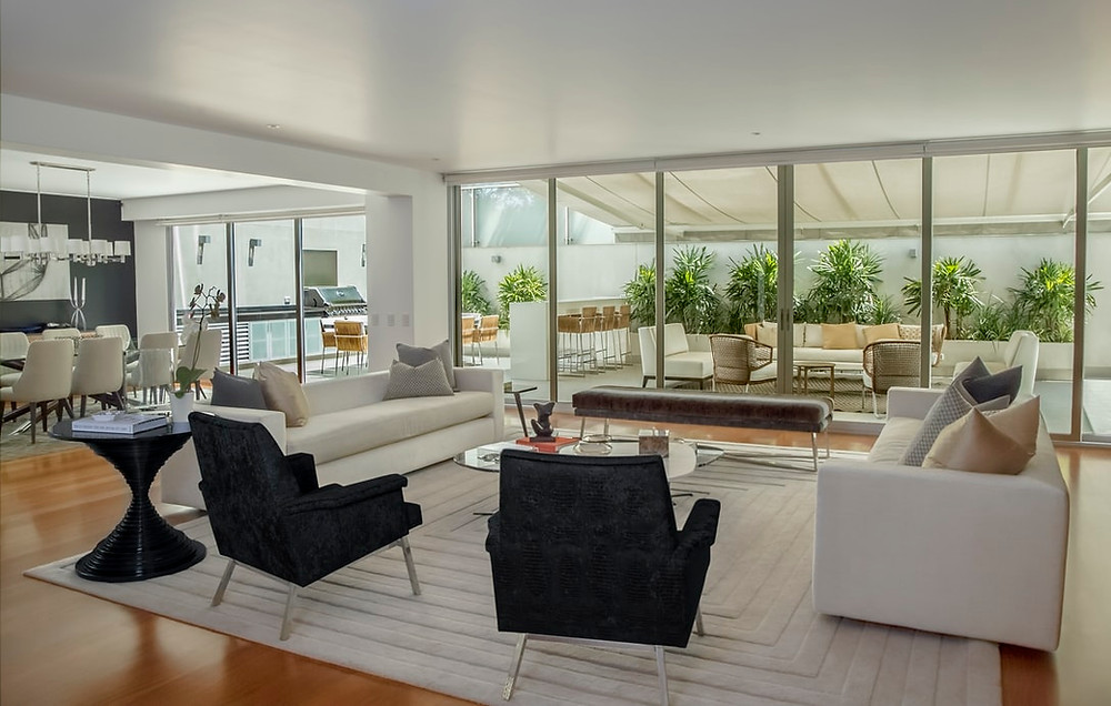 minimalist modern large home living room dinning room and terrace