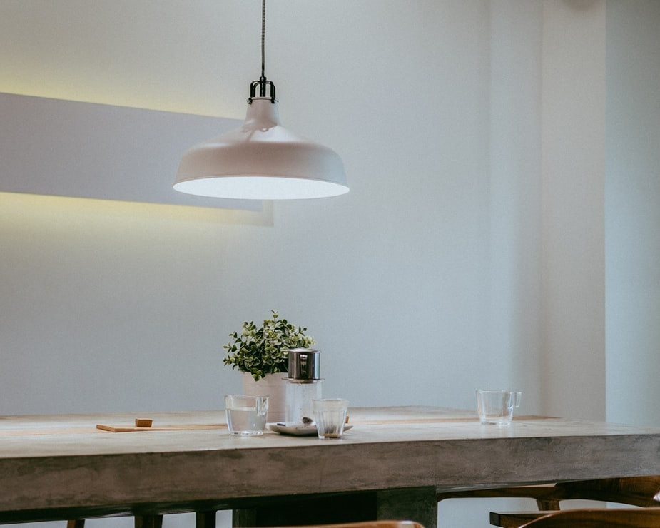 minimalist dining table with white ceiling lamp