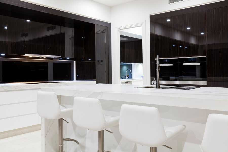 elegant minimalist kitchen white and dark wood
