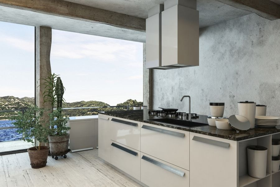 minimalist kitchen white cabinets and concrete wall with sea view