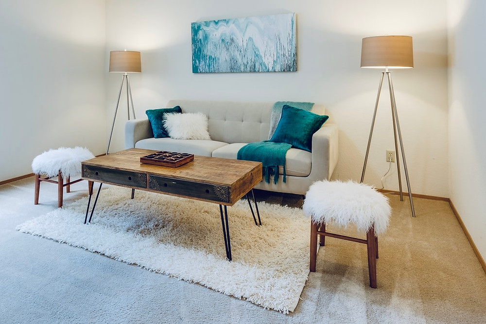 minimalist living room in cream and turquoise