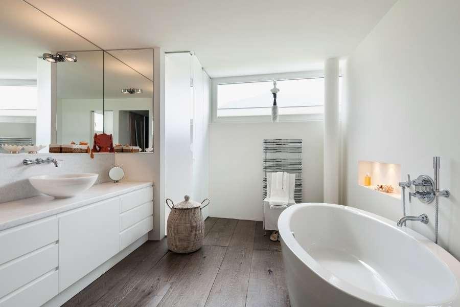 white minimalist bathroom with wooden floor design tips