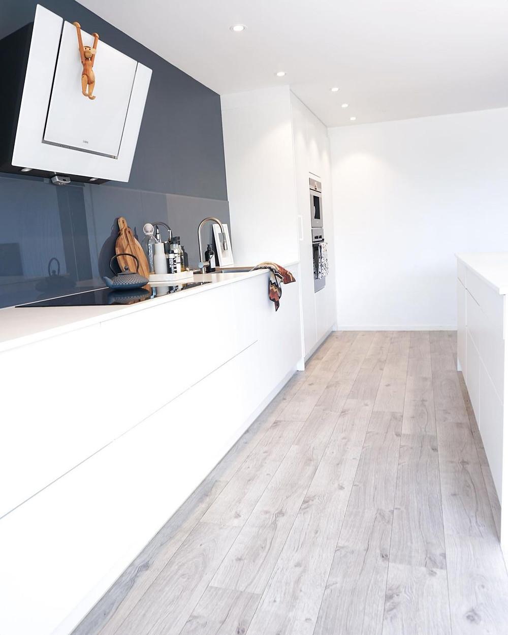 minimalist kitchen with navy blue accents