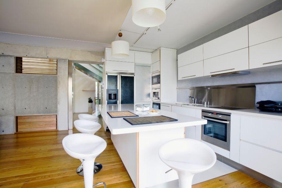 minimalist kitchen wood floor and concrete walls