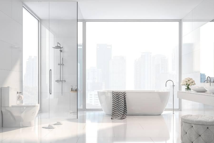 white minimalist bathroom with city skyline view, decoration tips