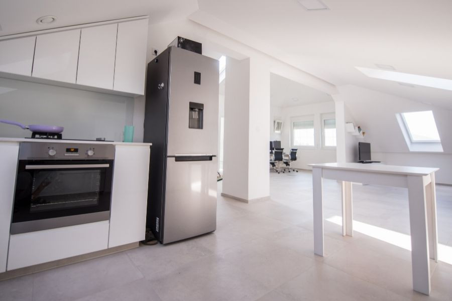 minimalist white kitchen for an office or open plan pad