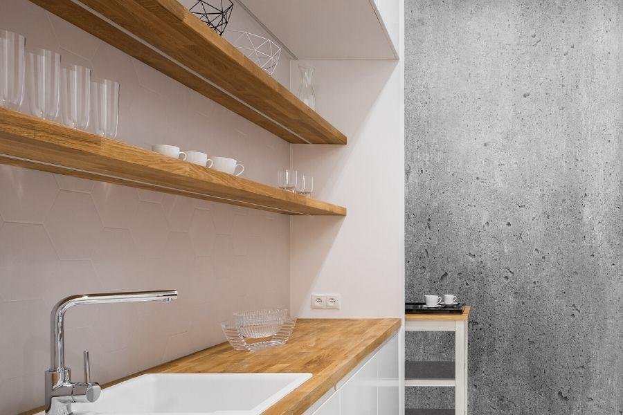 minimalist kitchen open shelves concrete wall