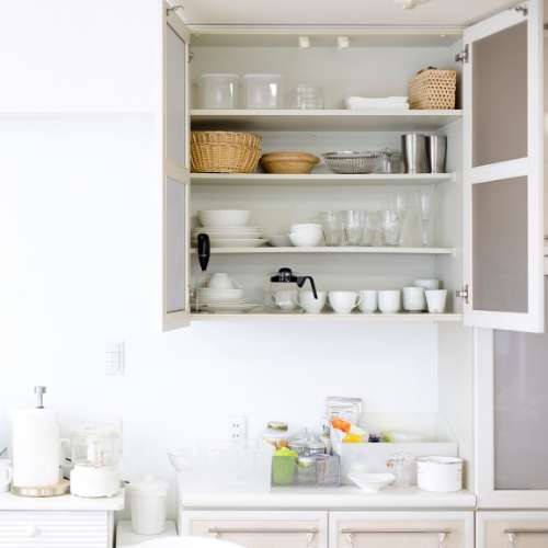 white kitchen organized cabinets