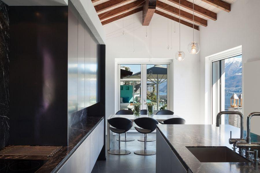 minimalist kitchen elegant black kitchen with ceiling beam and seaside
