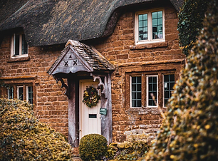 Thatched Cottage Cotswold Village.png