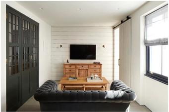 sofa and media wall.JPG