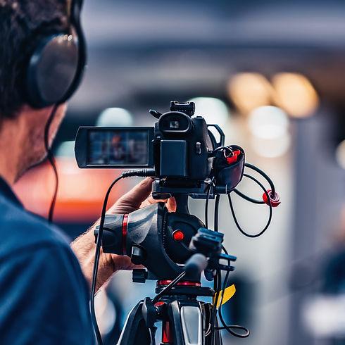 cameraman-recording-event-at-media-press