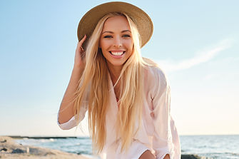 Young attractive smiling blond woman in