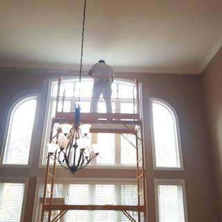 Painter on scaffolding