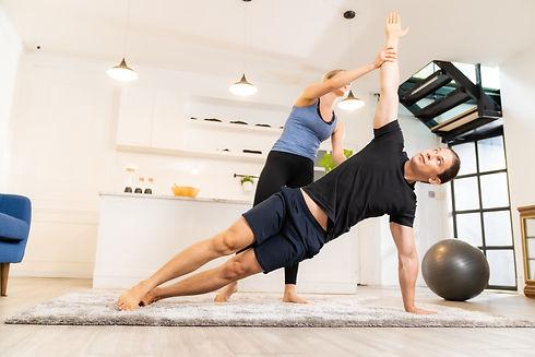 White caucasian man learning yoga at hom