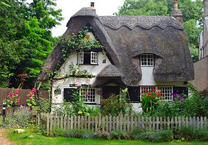 A beautiful, chocolate box cottage with thatched roof