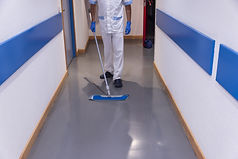 Man cleaning hospital corridor - dreamst