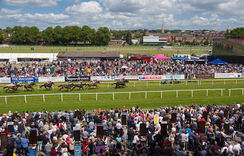 View of Worcester Racecourse showing crowds of spectators watching a horse race