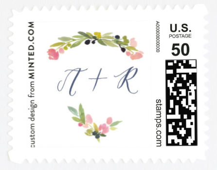 """A stamp with flowers and """"A + R"""" on it."""