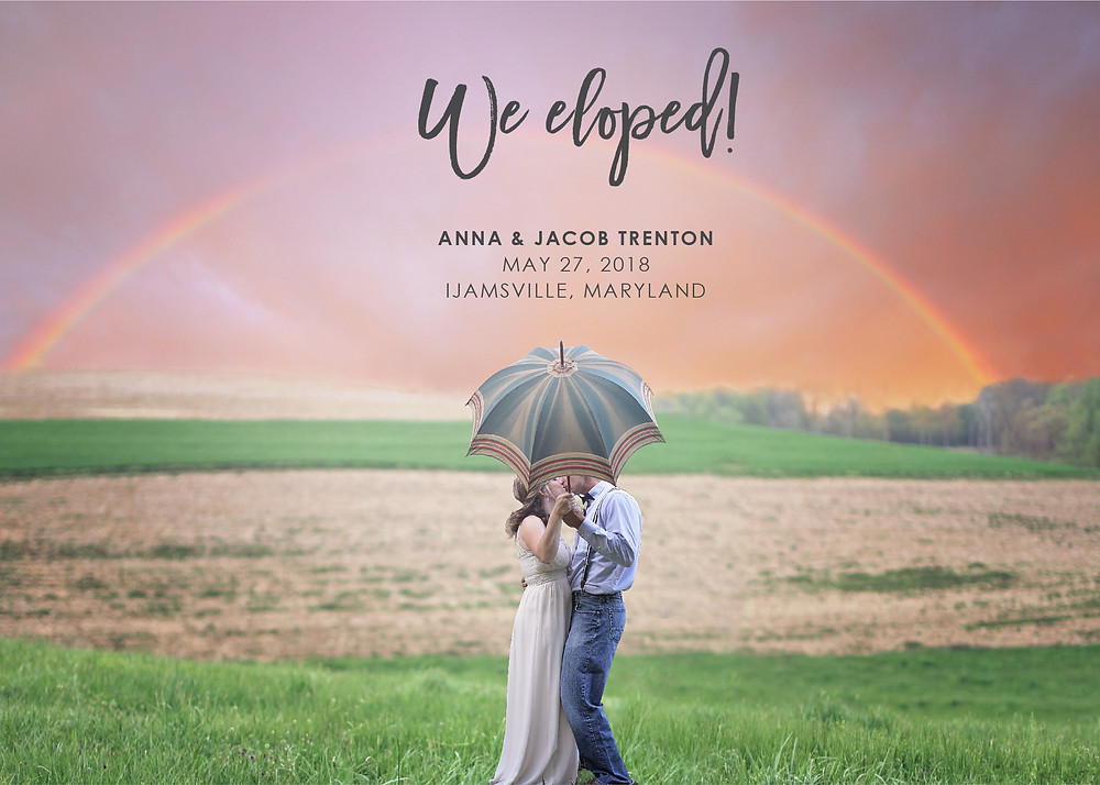 An elopemnt announcement with a picture of a couple with an umbrella standing under a rainbow.