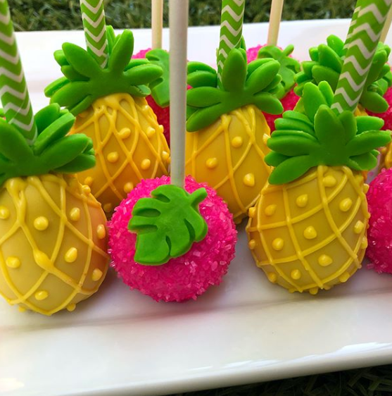 Cakepops in the shape of pineapples.