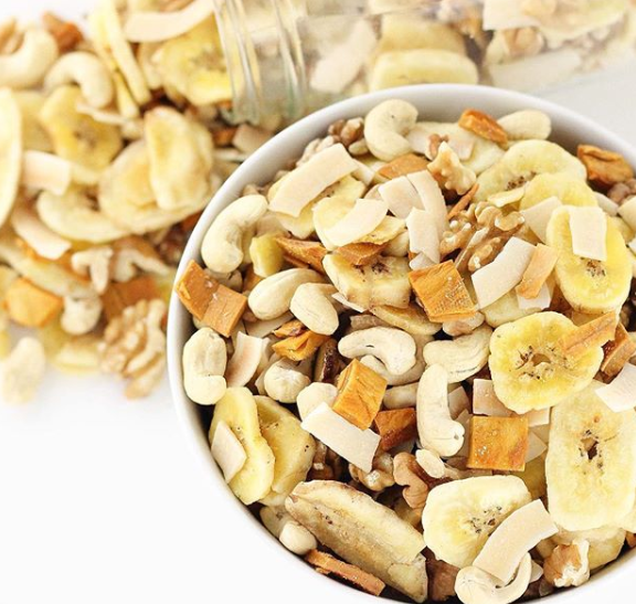 A trail mix with bananas, coconut, and nuts.