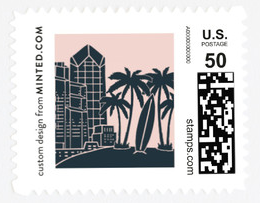 A stamp representing San Diego with palm trees, skyscrapers, and a surfboard on it.