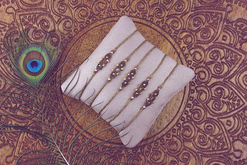 Nikiti Armbänder olive