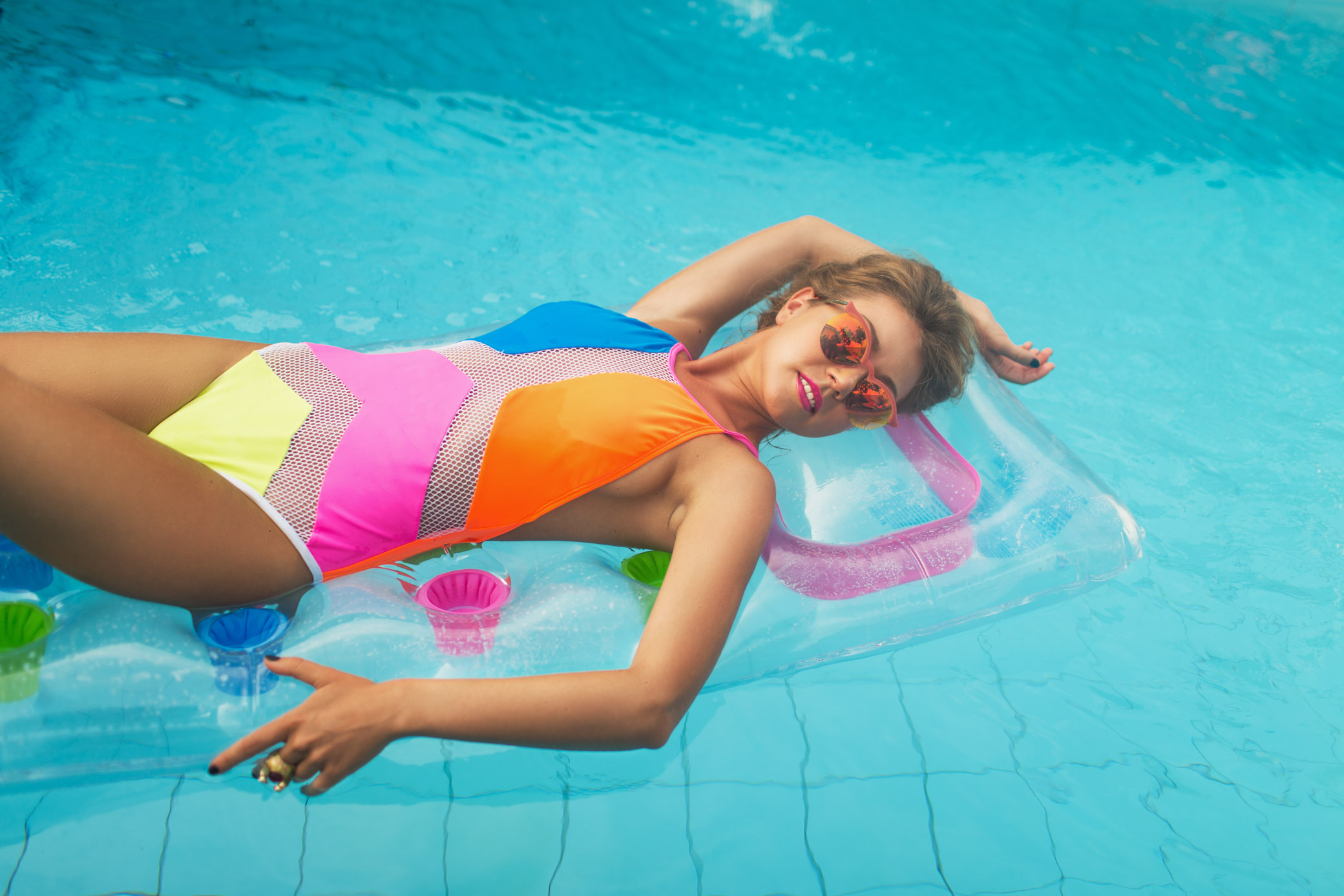 Fashion photoshoot in the pool
