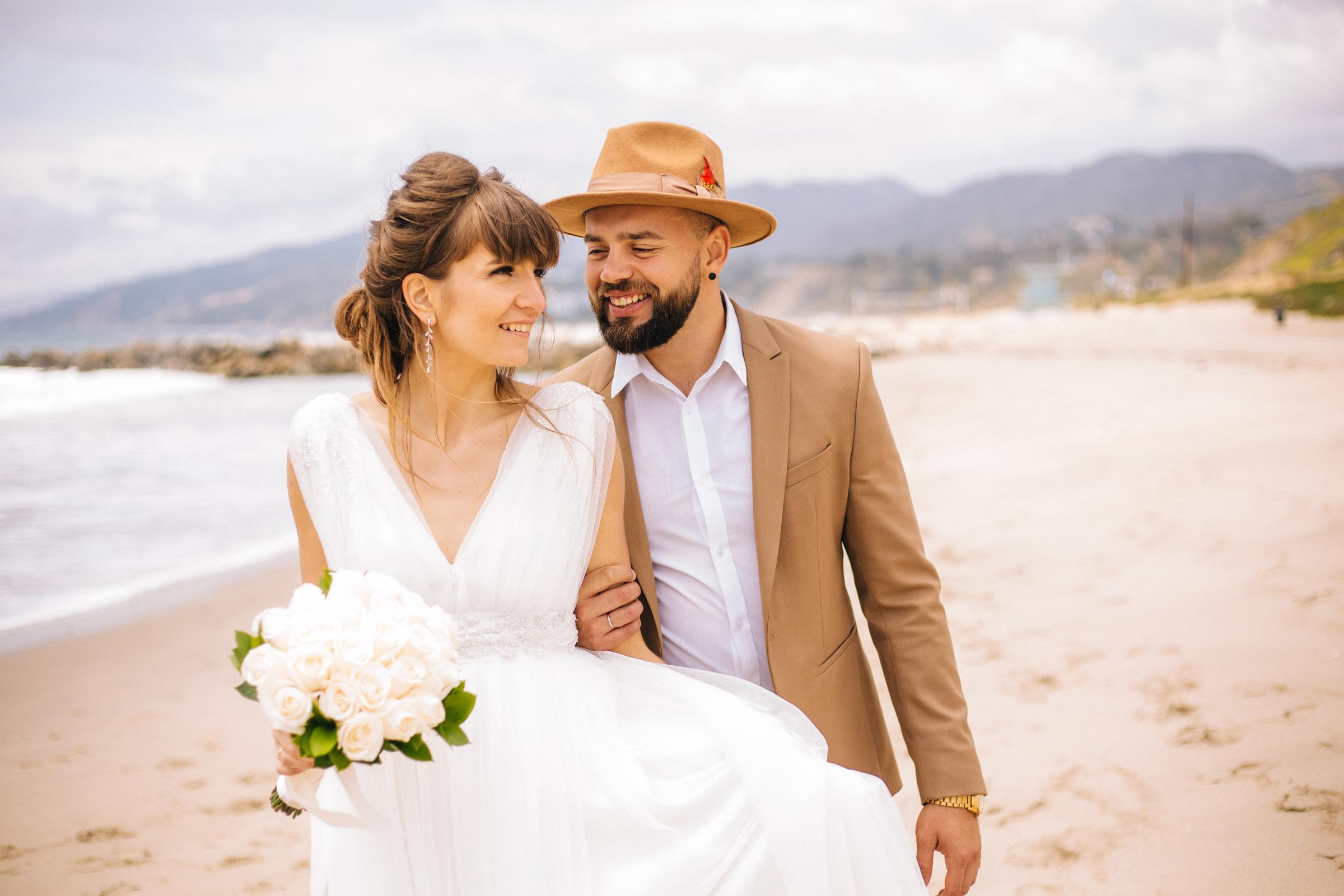 Happy bride and groom strolling along Lo