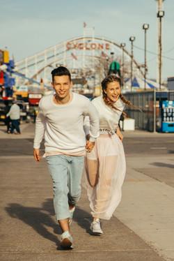 Loving couple runs holding hands