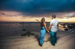 Loving couple looks at the fisherman