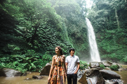 Guy and girl at the waterfall