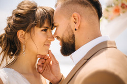 Bride and groom look at each other with