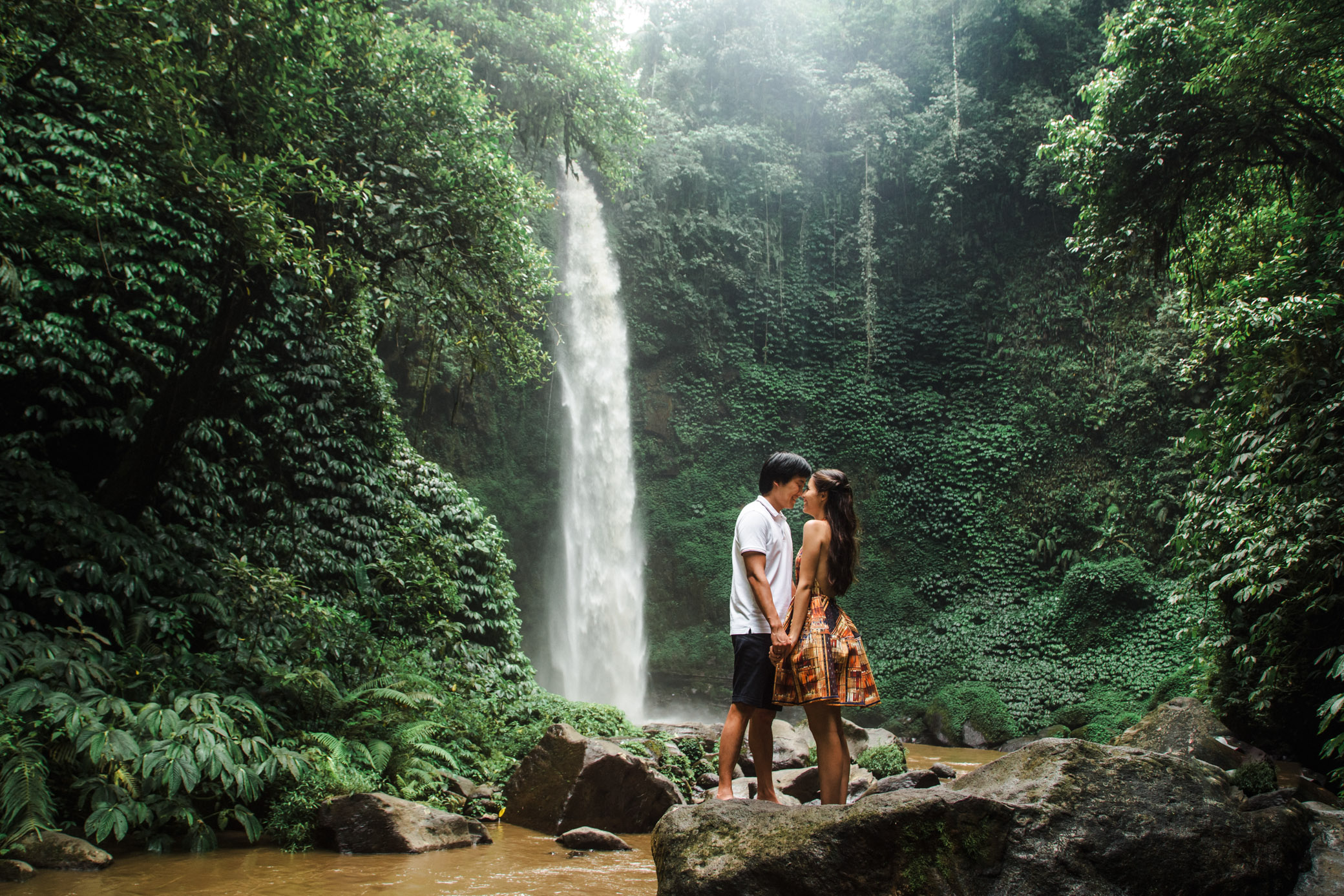 Loving Couple at the Waterfall