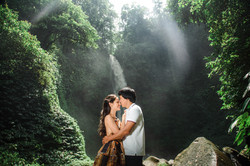 Couple cuddling at the waterfall