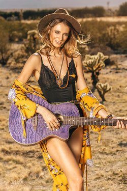 Snapshot of a wooman with a guitar