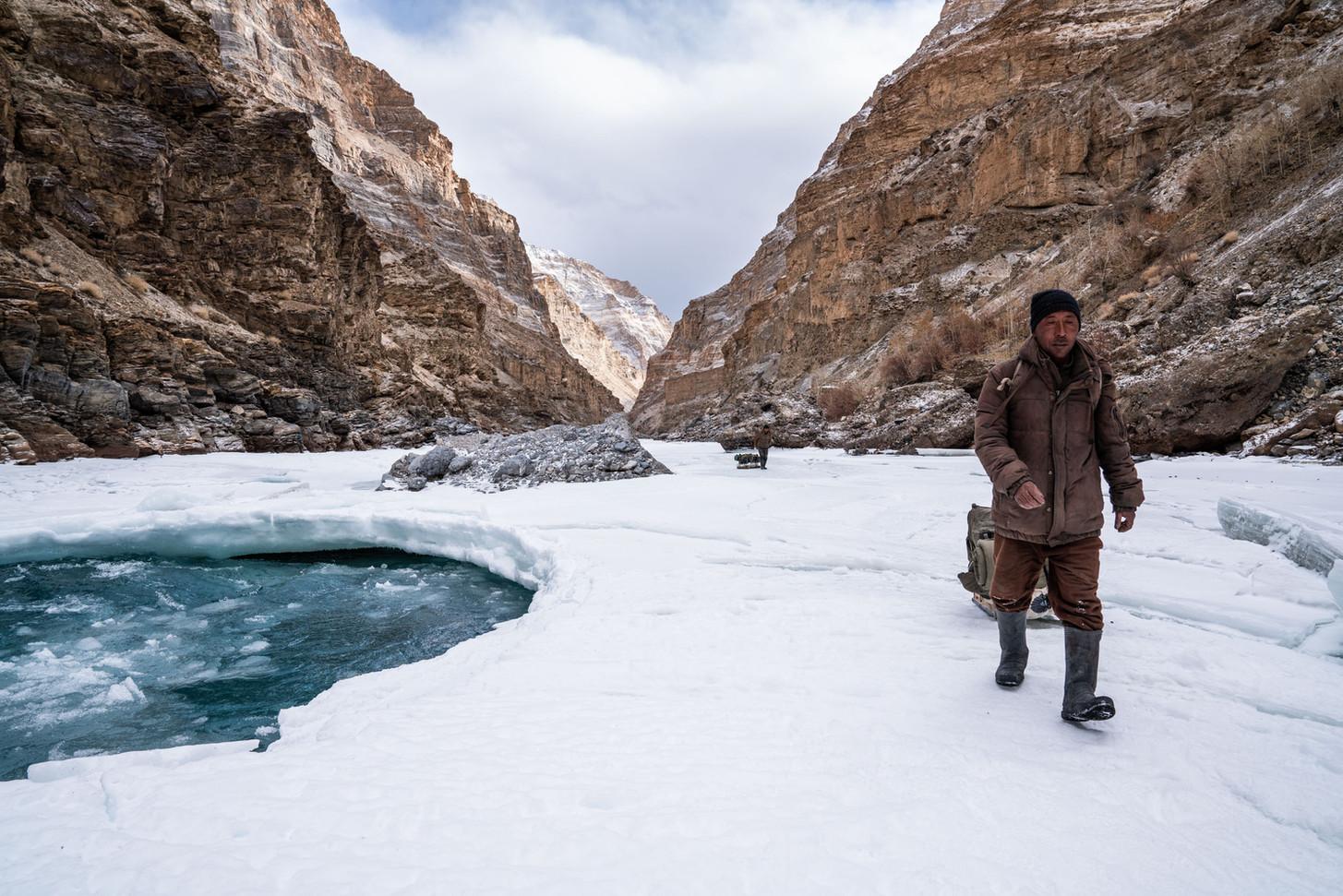 A Zanskari man walks along the  Chadar.