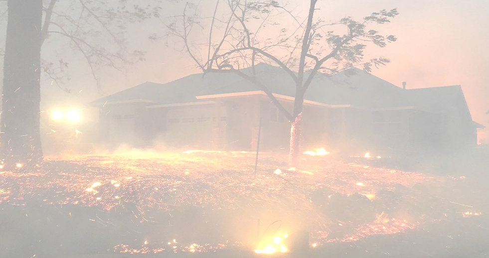 Background image of property fire prevention showing a burning house