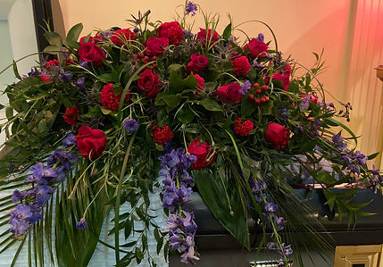Red Rose Blue Delph Casket Spray.jpg