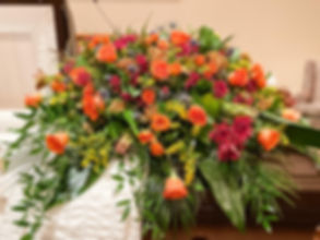 Orange Rose Casket Spray.jpg