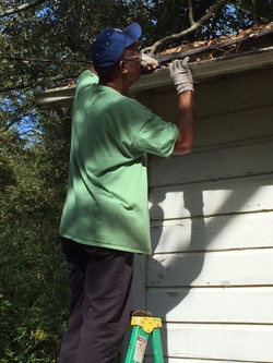 Victor unscrewing gutters