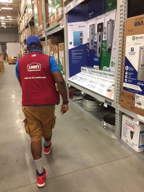 Lowe's Employee going to water heater.jp